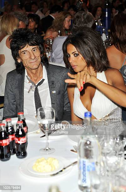 Ronnie Wood and girlfriend Ana Araujoattend the 35th Nordoff Robbins 02 Silver Clef Awards at London Hilton on July 2 2010 in London England