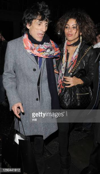 Ronnie Wood and his girlfriend Ana Araujo leave Nobu Berkeley restaurant on March 18, 2010 in London, England.