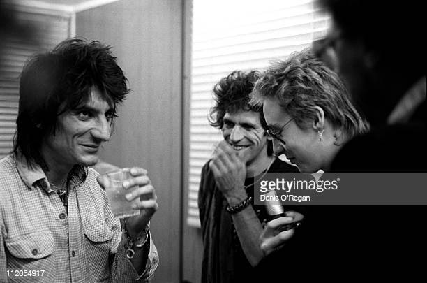Ronnie Wood and Keith Richards of the Rolling Stones with musician Julian Lennon circa 1983