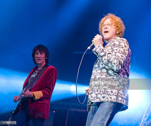 Ronnie Wood and Mick Hucknall of The Faces perform on stage during the second day of Cornbury Festival on July 2 2011 in Oxford United Kingdom