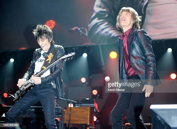 Ronnie Wood and Mick Jagger of The Rolling Stones perform at '121212' a concert benefiting The Robin Hood Relief Fund to aid the victims of Hurricane...