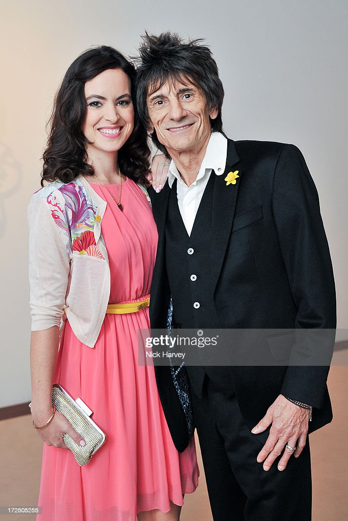 Ronnie Wood and Sally Wood attend the Masterpiece Midsummer Party in aid of Marie Curie at The Royal Hospital Chelsea on July 2, 2013 in London, England.