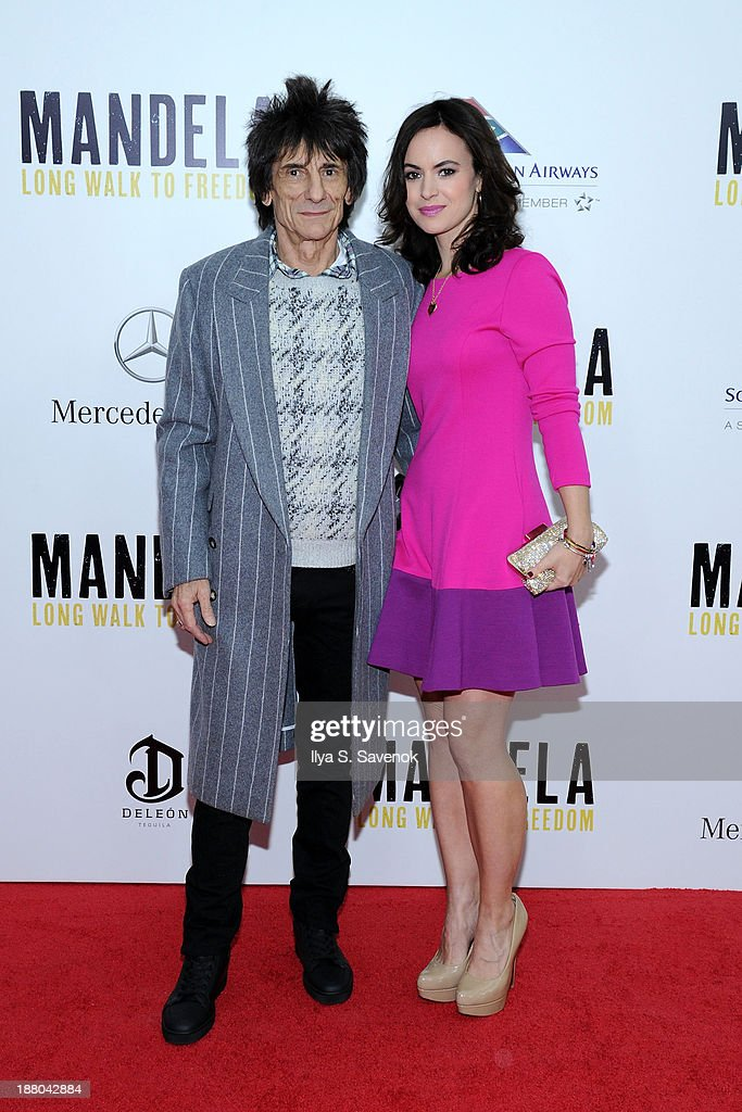Ronnie Wood and Sally Wood attend the New York premiere of 'Mandela: Long Walk To Freedom' hosted by The Weinstein Company, Yucaipa Films and Videovision Entertainment, supported by Mercedes-Benz, South African Airways and DeLeon Tequila at Alice Tully Hall, Lincoln Center on November 14, 2013 in New York City.