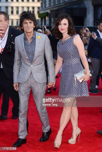 Ronnie Wood and Sally Wood attend the World Premiere of 'One Direction: This Is Us' at Empire Leicester Square on August 20, 2013 in London, England.