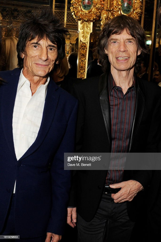 Ronnie Wood (L) and Sir Mick Jagger attend a private dinner hosted by L'Wren Scott & Mick Jagger celebrating her 2013 fall/winter collection at the Cafe Royal hotel on February 17, 2013 in London, England.
