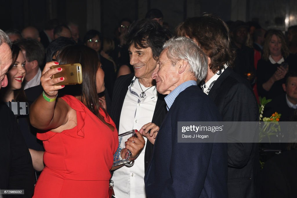 Ronnie Wood, Charlie Watts and Mick Jagger of The Rolling Stones pose with fans at the Jazz FM Awards 2017 at Shoreditch Town Hall on April 25, 2017 in London, United Kingdom.