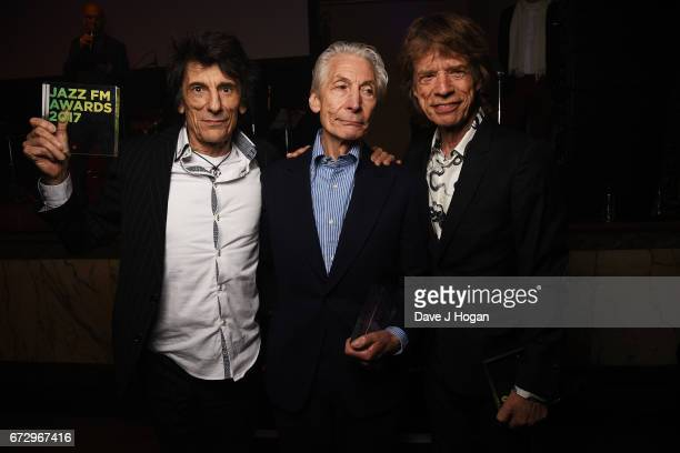 Ronnie Wood Charlie Watts and Mick Jagger of The Rolling Stones accept the award for Album Of The Year Public Vote for their album 'Blue Lonesome' at...