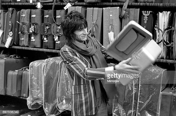 Ronnie Wood choosing a suitcase in a shop April 1975 75-01104-009