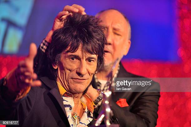 Ronnie Wood from the rock group the Rolling Stones with his Outstanding Contribution award onstage with Pete Townshend during the Classic Rock Roll...
