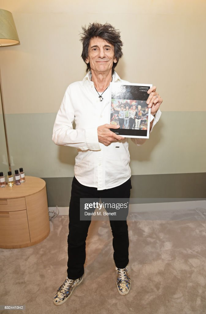 Ronnie Wood holds a copy of his new book 'Ronnie Wood: Artist' at Selfridges on August 15, 2017 in London, England.