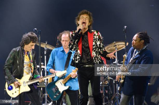 Ronnie Wood Keith Richards Mick Jagger and Darryl Jones of The Rolling Stones perform onstage at Hard Rock Stadium on August 30 2019 in Miami Gardens...