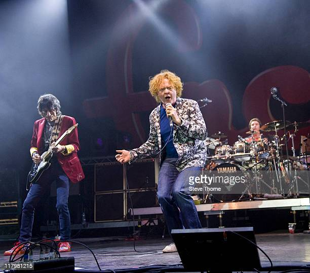 Ronnie Wood Mick Hucknall and Kenney Jones of The Faces perform on stage during the second day of Cornbury Festival on July 2 2011 in Oxford United...