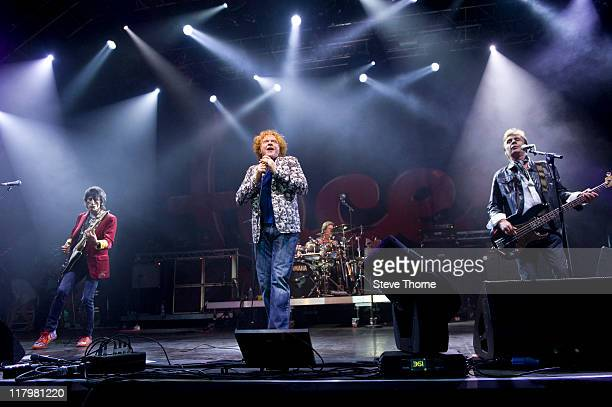 Ronnie Wood Mick Hucknall Kenney Jones and Glen Matlock of The Faces perform on stage during the second day of Cornbury Festival on July 2 2011 in...