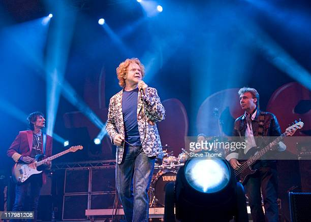Ronnie Wood Mick Hucknall Kenny Jones and Glen Matlock of The Faces perform on stage during the second day of Cornbury Festival on July 2 2011 in...