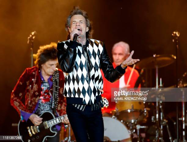 Ronnie Wood Mick Jagger and Charlie Watts of the Rolling Stones perform as they resume their No Filter Tour North American Tour at the Soldier Field...