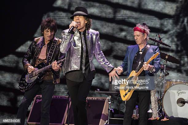 Ronnie Wood Mick Jagger and Keith Richards of English rock band The Rolling Stones performing live onstage at The O2 Arena in London November 29 2012