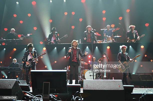 Ronnie Wood Mick Jagger and Keith Richards of The Rolling Stones perform at '121212' a concert benefiting The Robin Hood Relief Fund to aid the...