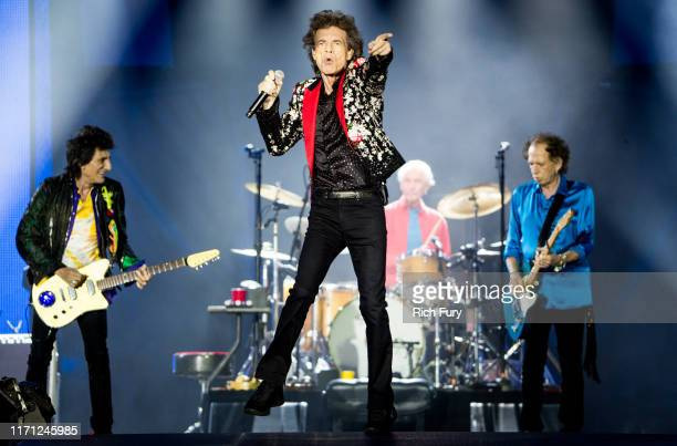Ronnie Wood Mick Jagger Charlie Watts and Keith Richards of The Rolling Stones perform onstage at Hard Rock Stadium on August 30 2019 in Miami Florida