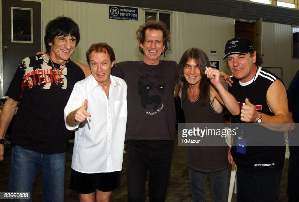 Ronnie Wood of The Rolling Stones Angus Young of AC/DC Keith Richards of The Rolling Stones Malcolm Young of AC/DC and Brian Johnson of AC/DC