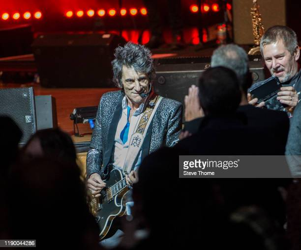 Ronnie Wood performs in the audience at Symphony Hall on November 25 2019 in Birmingham England