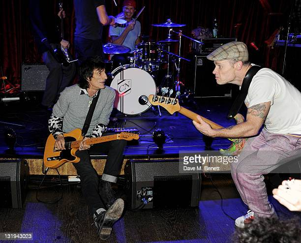 Ronnie Wood performs with Chad Smith and Flea of the Red Hot Chili Peppers at the launch of Flea and Damien Hirst's new line of Spin Bass Guitar at...