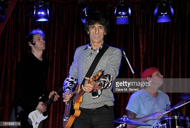 Ronnie Wood performs with Josh Klinghoffer and Chad Smith of the Red Hot Chili Peppers at the launch of Flea and Damien Hirst's new line of Spin Bass...