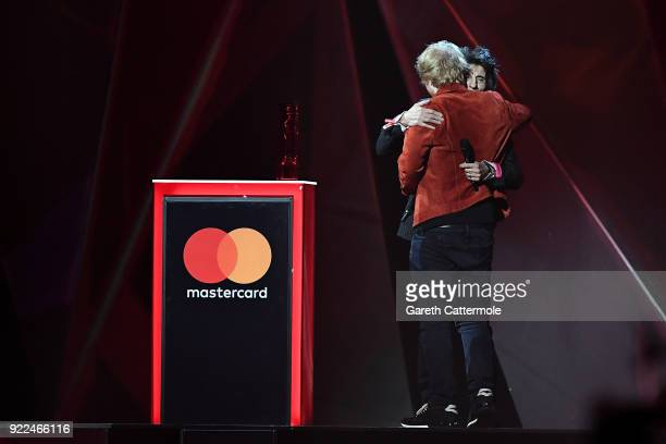 AWARDS 2018 *** Ronnie Wood presents Ed Sheeran with the Global Success 2018 award at The BRIT Awards 2018 held at The O2 Arena on February 21 2018...