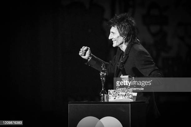 Ronnie Wood presents the Best Male Solo Artist award during The BRIT Awards 2020 at The O2 Arena on February 18 2020 in London England