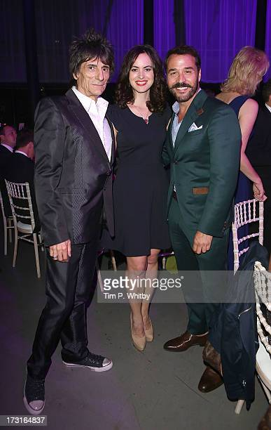 Ronnie Wood Sally Himphreys and Jeremy Piven attend the Novak Djokovic Foundation inaugural London gala dinner at The Roundhouse on July 8 2013 in...