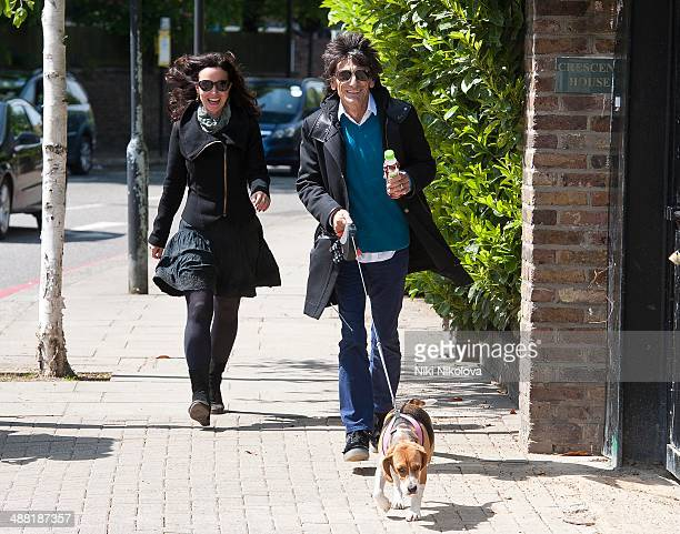 Ronnie Wood Sally Humphreys and Mr Hudson are seen in Holland Park on May 4 2014 in London England