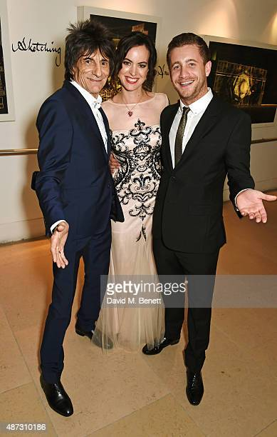 Ronnie Wood Sally Wood and Tyrone Wood attend the GQ Men Of The Year Awards after party at The Royal Opera House on September 8 2015 in London England