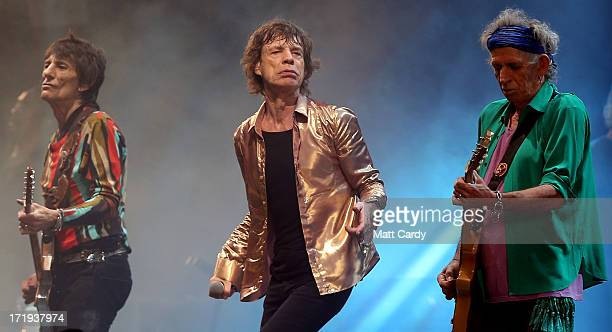 Ronnie Wood Sir Mick Jagger and Keith Richards of The Rolling Stones performs on the Pyramid Stage at Glastonbury Festival 2013 on June 29 2013 in...