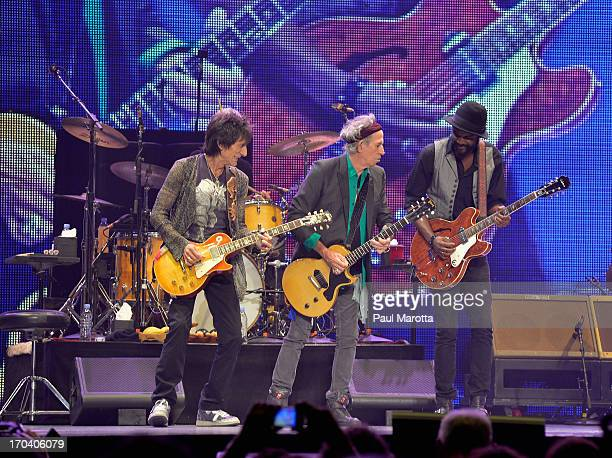 Ronnie Woods and Keith Richards of the Rolling Stones and guitarist Gary Clarke perform at TD Garden on June 12 2013 in Boston Massachusetts