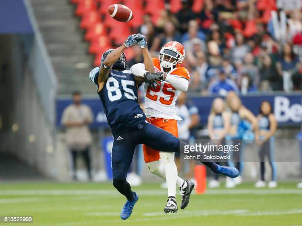 Ronnie Yell of the BC Lions defends a pass to DeVier Posey of the Toronto Argonauts during a CFL game at BMO field on June 30 2017 in Toronto Ontario...