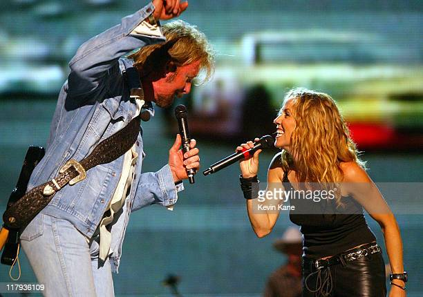 RonnieDunn with Sheryl Crow during Dale EarnhardtTribute Concert at Daytona International Speedway in Daytona Beach Florida United States