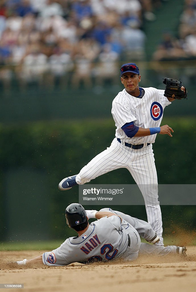 Ronny Cedeno, Chicago Cub shortstop, avoids a sliding Xavier Nady at Wrigley Field in Chicago, Illinois on July 14, 2006. The New York Mets over the Chicago Cubs by a score of 6 to 3.