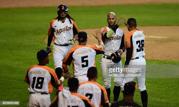 Ronny Cedeno of Aguilas del Zulia from Venezuela celebrates with teammates after scoring against Alazanes de Granma from Cuba during the Caribbean...
