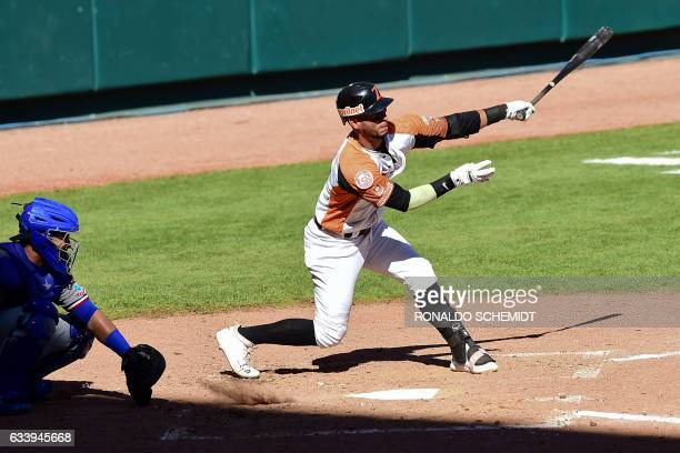 Ronny Cedeno of Aguilas del Zulia of Venezuela bats against Tigres del Licey of the Dominican Republic during the Caribbean Baseball Series at the...
