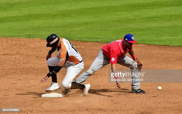 Ronny Cedeno of Aguilas del Zulia of Venezuela slides safe in second base during a Caribbean Baseball Series match against Criollos de Caguas from...