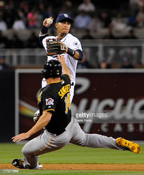 Ronny Cedeno of the San Diego Padres throws over Gaby Sanchez of the Pittsburgh Pirates as he tries to turn a double play during the second inning of...