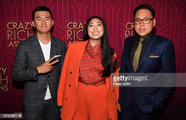 Ronny Chieng Awkwafina and Nico Santos attend the Crazy Rich Asians Atlanta Red Carpet Screening at Regal Atlantic Station on August 2 2018 in...