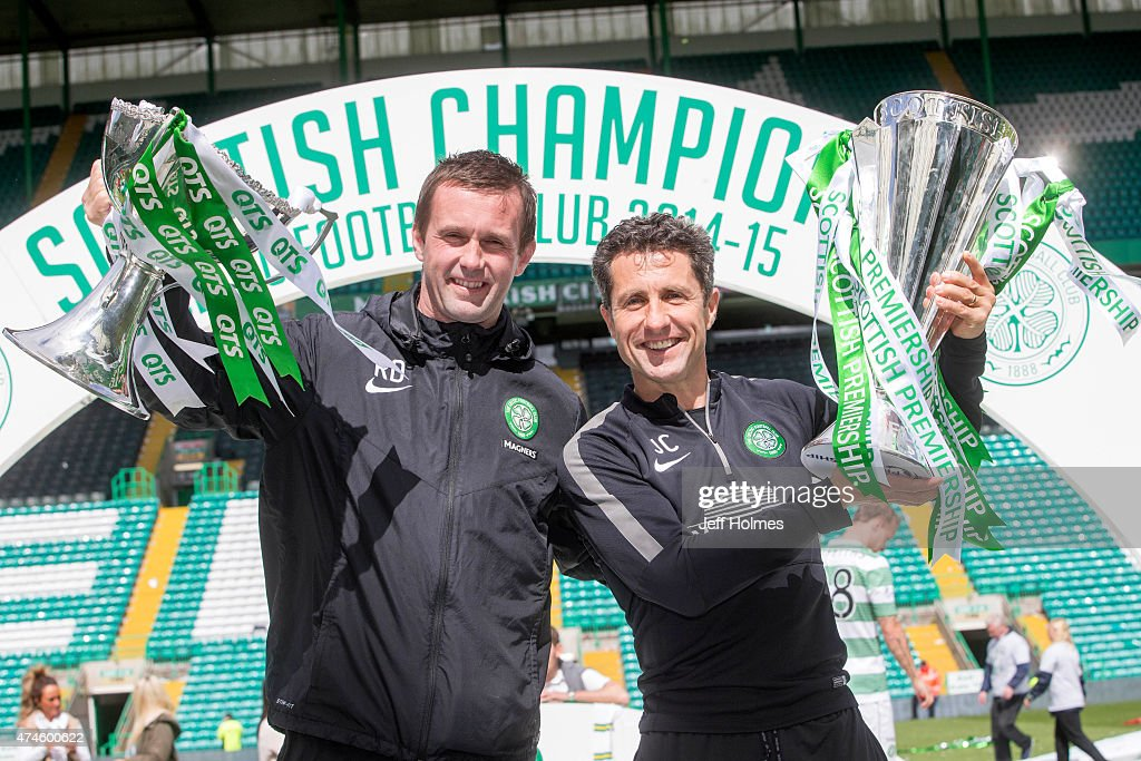 Ronny Deila (L) Celtic manager lifts trophy with assistant John Collins with League Cup after winning the Scottish Premiership Match between Celtic and Inverness Caley Thistle at Celtic Park on May 24, 2015 in Glasgow, Scotland.