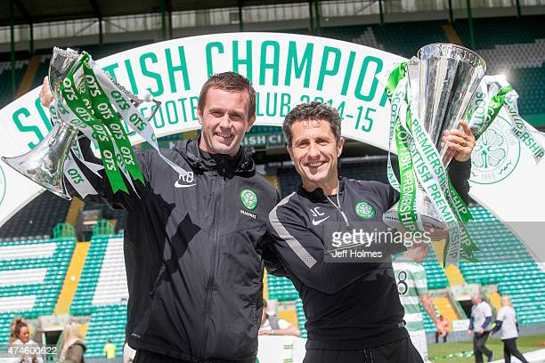 Ronny Deila Celtic manager lifts trophy with assistant John Collins with League Cup after winning the Scottish Premiership Match between Celtic and...