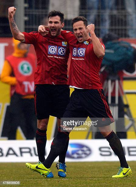 Ronny Garbuschweski of Chemnitz celebrates his team's second goal with team mate Sascha Pfeffer during the third Bundesliga match between Stuttgarter...