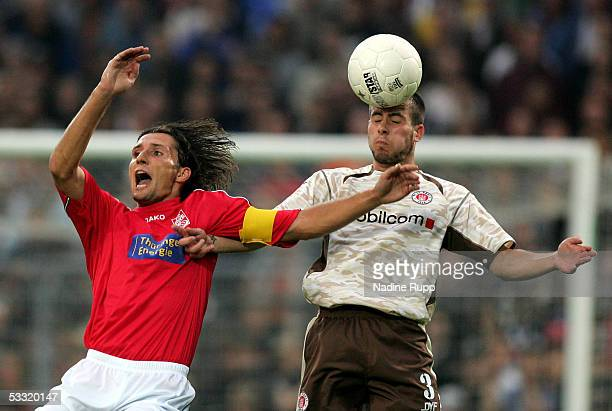 Ronny Hebestreit of Erfurt competes with Ian Joy of Pauli during the match of the Third Bundesliga between FC St Pauli and Rot Weiss Erfurt on August...
