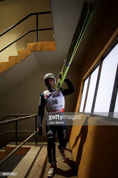 Ronny Heer of Switzerland walks up to the hill prior to the Ski Jumping event of the FIS Nordic Combined World Cup at the HansRennerSchanze on...