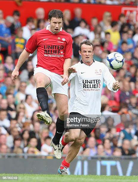 Ronny Johnsen clashes with Austin Healy during the United Relief charity match in aid of Sport Relief and the Manchester United Foundation between...