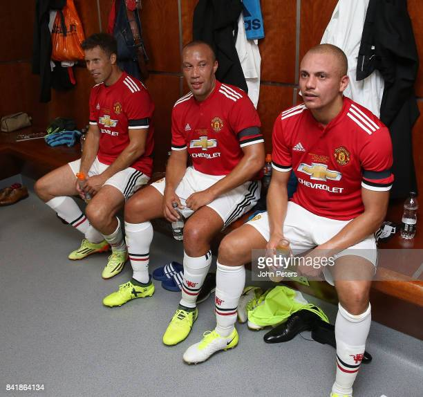 Ronny Johnsen Mikael Silvestre and Wes Brown of Manchester United Legends sit in the dressing room at halftime during the MU Foundation charity match...