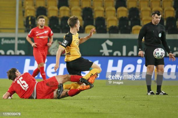 Ronny Koenig of FSV Zwickau and Tim Knipping of SG Dynamo Dresden and referee Alexander Sather battle for the ball during the 3 Liga match between...