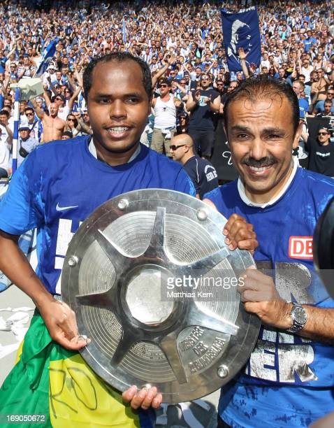 Ronny of Berlin and head coach Jos Luhukay pose with the cup after winning the championship after the Second Bundesliga match between Hertha BSC...